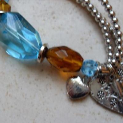 Bracelet billes métal argenté  et perle turquoise.