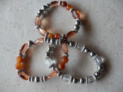 Bracelet 3 rangs perles marron-métal.
