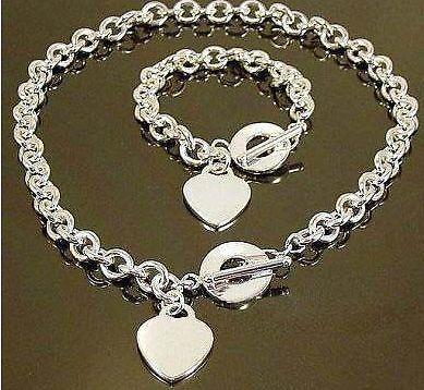 Parure plaqué argent, collier et bracelet, fermoir T et coeur rond.