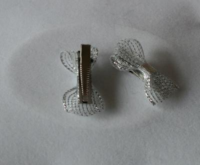 Barettes-pinces noeud papillon argent.