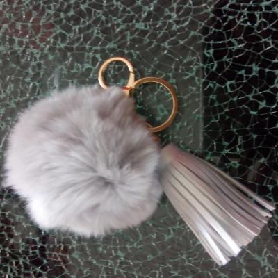 Porte-clé, bijou de sac pompon gris et pompon cuir
