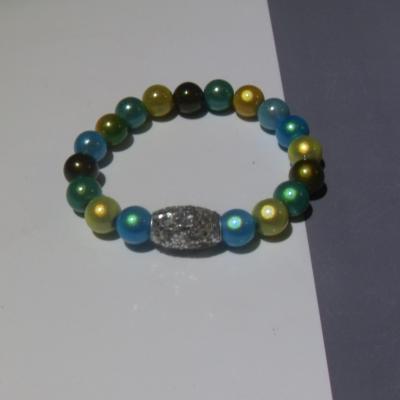 Bracelet bleu-vert-jaune, perles magiques et paillettes.