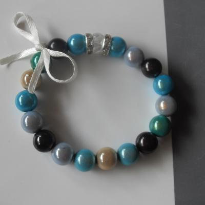 Bracelet multicolore, perles magiques, cristal swarovski et strass blanc.