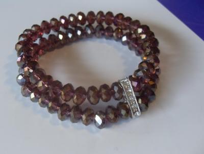 Bracelet 2 rangs de perles en cristal de swarovski prune et strass.