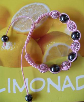 Bracelet shamballa rose, 5 sphères strass de verre et hématites sur cordon rose.