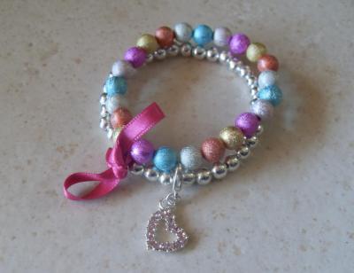 Bracelet perles multicolores-turquoise-argenté, ruban et son charm's coeur strass.