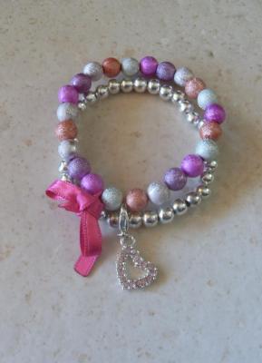 Bracelet perles multicolores- rose-argenté, ruban et son charm's coeur strass.